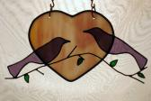 Purple stained glass love birds