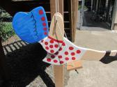 Handmade custom painted Girl in a bonnet on a swing