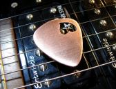 Personalized copper guitar pick with hand sawed heart