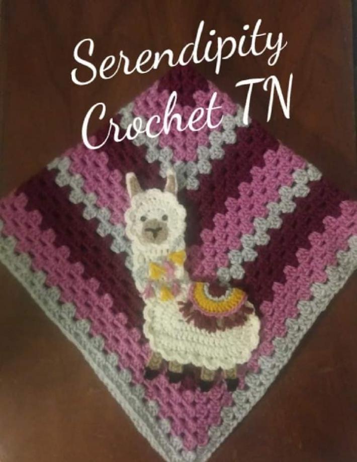 crocheted llama granny square blanket