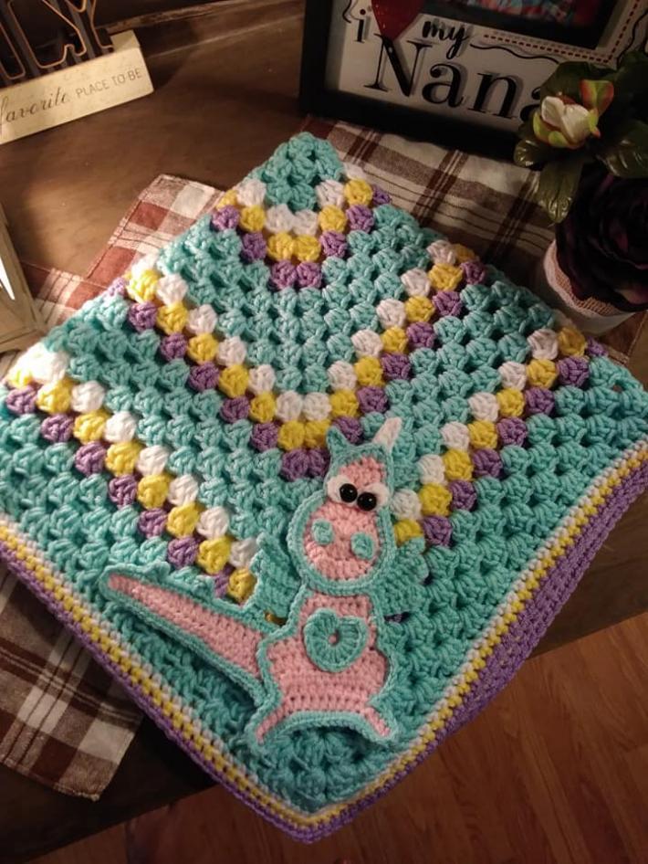 crocheted dragon granny square  blanket