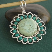Sunflower wire wrapped pendant in blue green