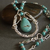 Montana wire wrapped necklace blue green and sterling silver