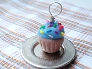 Blue Iced Cupcake with Rainbow Sprinkles