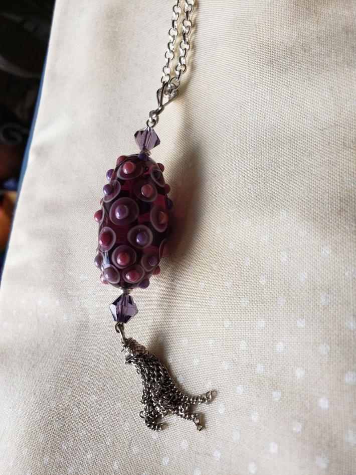 Lamp work bead in dark purple with tassel