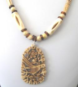 Handcrafted Necklace with Carved Bone Pendant and Bone and Wood Beads