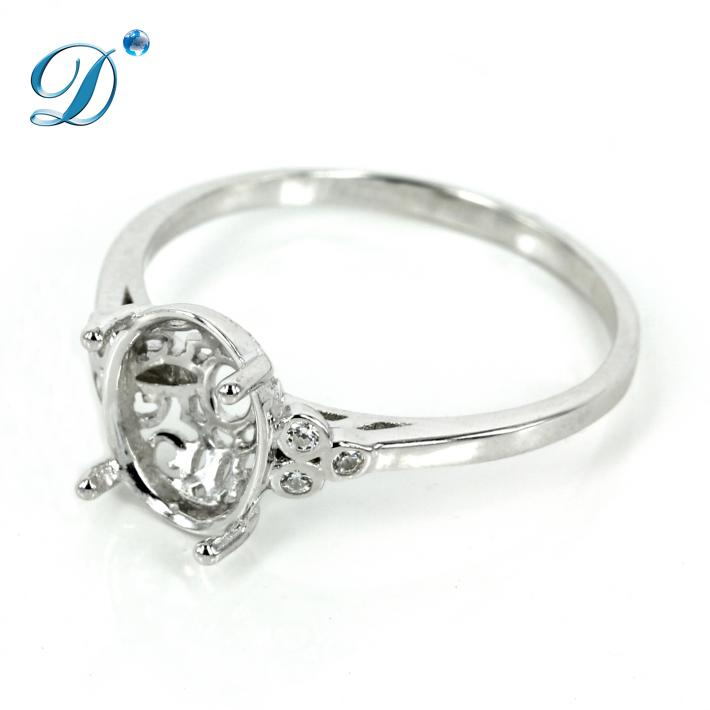 Elegant gallery style basket setting ring with trios of Cubic Zirconias in sterling silver 8x10mm
