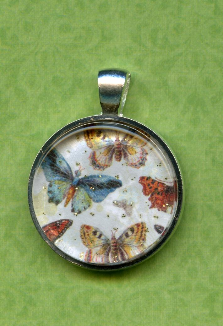 Glitter and Butterflies on a 1 inch Round Glass Tile in a Silver Bezel Setting