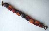 Tricolour wooden bead bracelet on leather cord