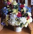 Spring Flower Arrangement Time began in a garden water can