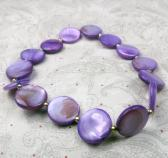 Stretchy purple shell bracelet with seed beads