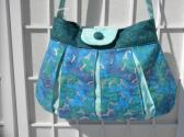 Handmade Purse Aquamarine pleated purse Jump into spring and summer with this delicate bag