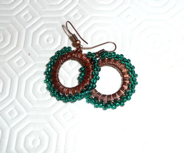 Earrings copper wire wrapped oxidized patinated glass teal green hoops wire work beaded hoops spring