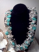 Turquoise colored Magnesite with handsewn fringe