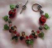 Holly and Roses a Christmas Themed Lampwork Bracelet