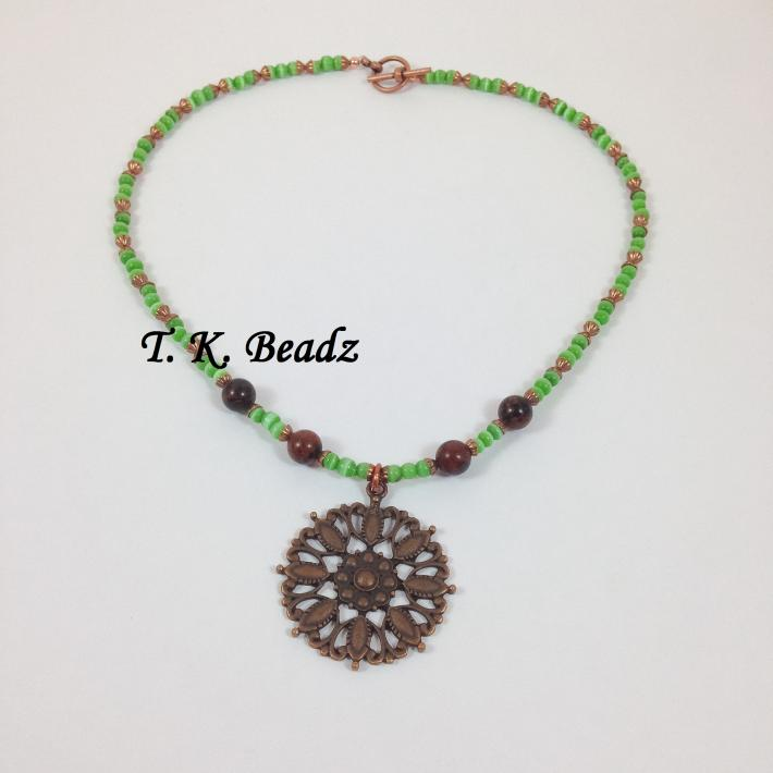 Copper Medallion with Mahogany Obsidian and Green Cat's Eye