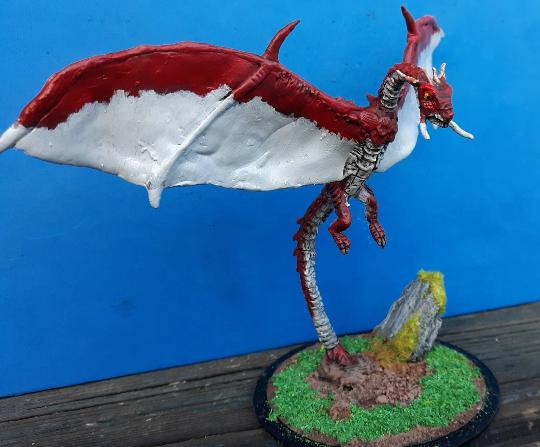 Sculpted tusked dragon figure