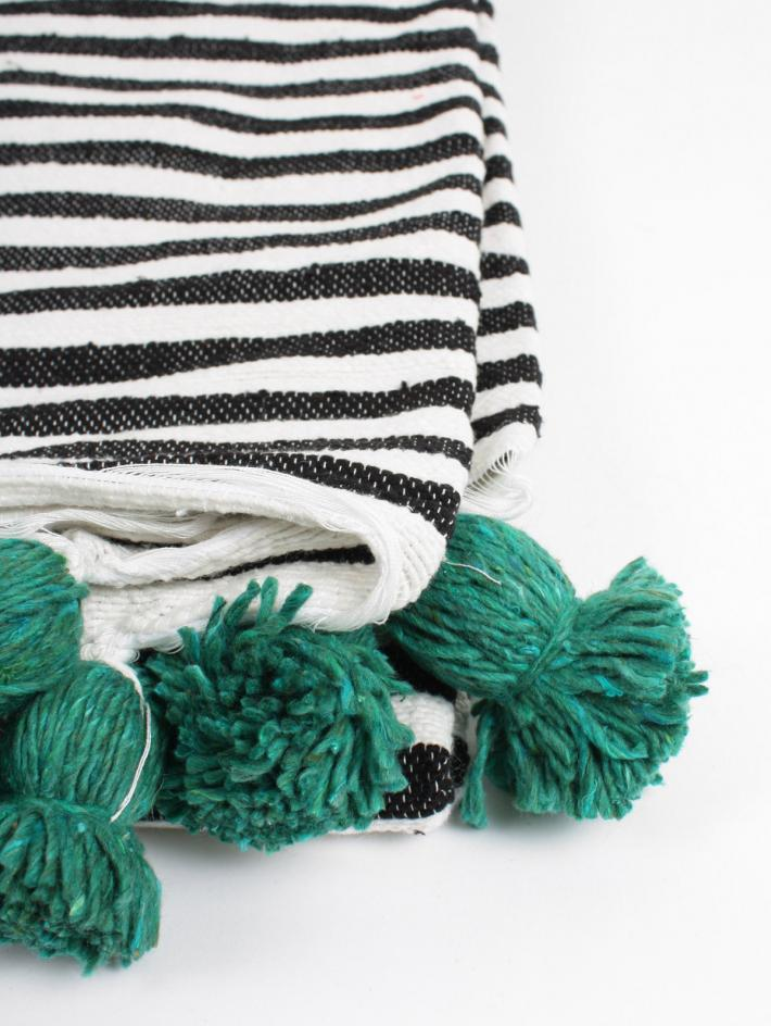 Moroccan cotton blanket with pom poms
