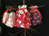 Set of three fabric drawstring bags