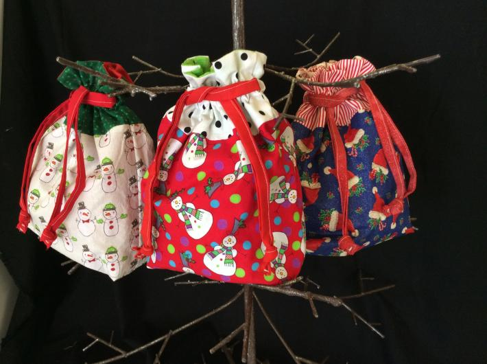 Set of three fabric drawstring bags