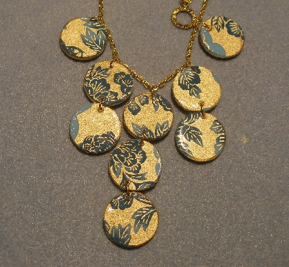 Reversible blue and gold decoupage paper necklace