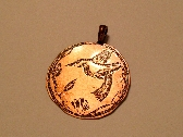 etched hummingbird pendant