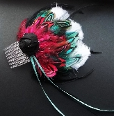 Feather hair comb in shades of magenta turquoise black and white by ACA