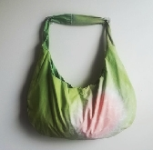 Bright green hand dyed hobo bag with rosy center and matching straps