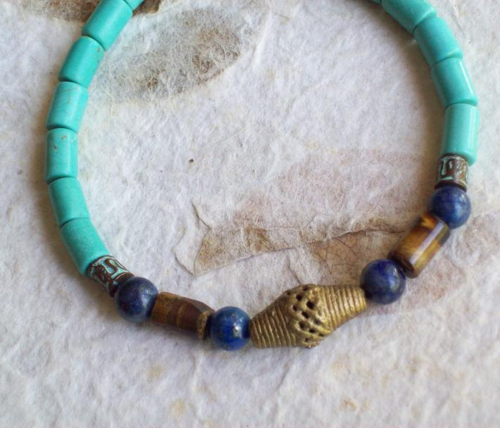 Amenhotep Turquoise and Lapis Lazuli beaded stretch bracelet with Tigers Eye cylinders and African Brass Rice bead