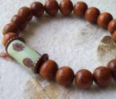 Majorca Bracelet with Bayong wood beads and antique Mint Green Venetian Millefiori African trade bead