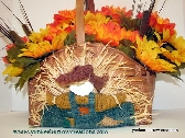 fall silk flower basket with scarecrow