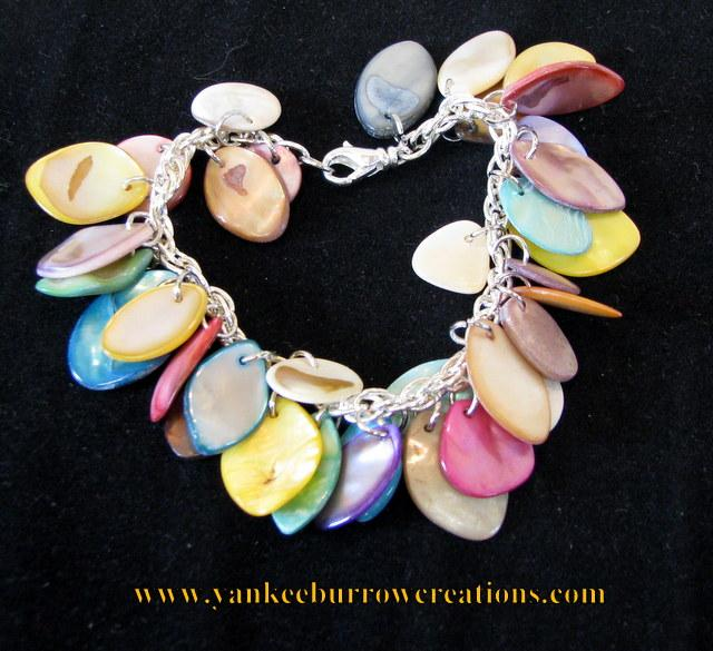 bracelet with multicolored shells on a double silver plated chain