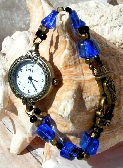 Antique Brass Watch with Blue and Black Glass
