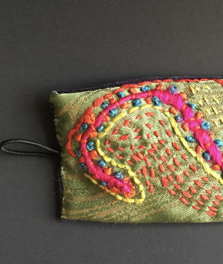 Textile Cuff with embroidery and flowers pattern