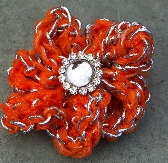 Orange and silver flower hair clip