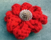 Bright red wool flower hair clip