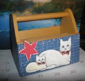 Painted cats on wooden mail holder
