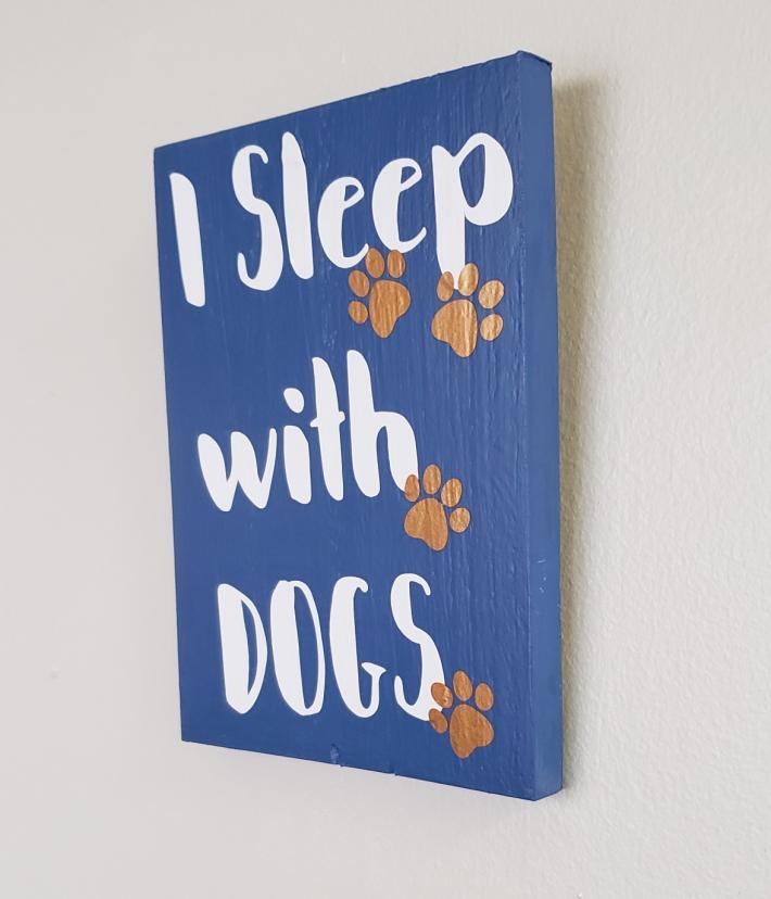 I Sleep with Dogs Sign on wood