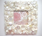 Picture frame with white and pearl buttons