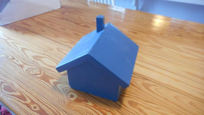 Blue house box with hinged roof