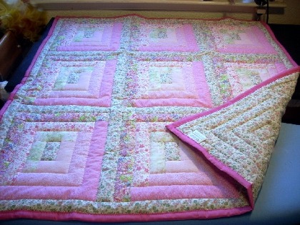 Hand Quilted Log Cabin Baby quilt in Shades of Pink