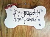 Wood sign grandchild has paws