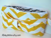 Yellow chevron bow clutch purse with wrist strap