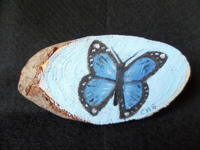 Blue Butterfly on Wood Slice