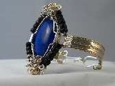 Blue Lapis and Black Onyx Handwrapped in Sterling Silver Filled and 14kt Rolled Gold Handmade Bracelet