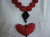 What is Black Red and Flies Butterfly Necklace of Cinnabars