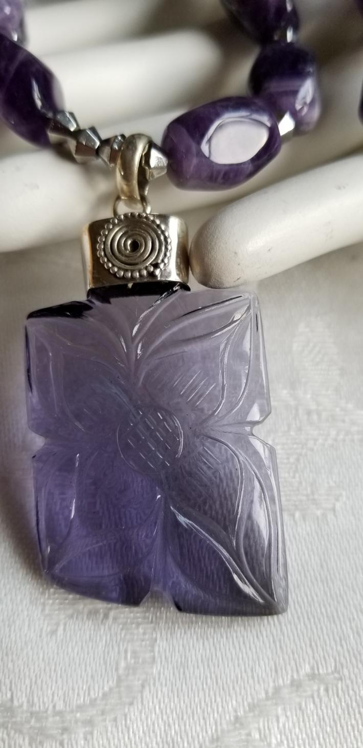 Purple Flowers                              Carved Amethyst Flower Necklace