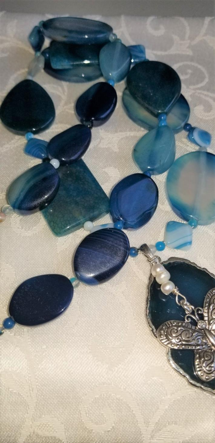 Fluttering By                                             Blue Agates with a Butterfly Necklace