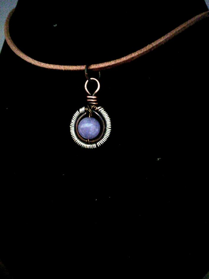 Small amethyst coiled pendant