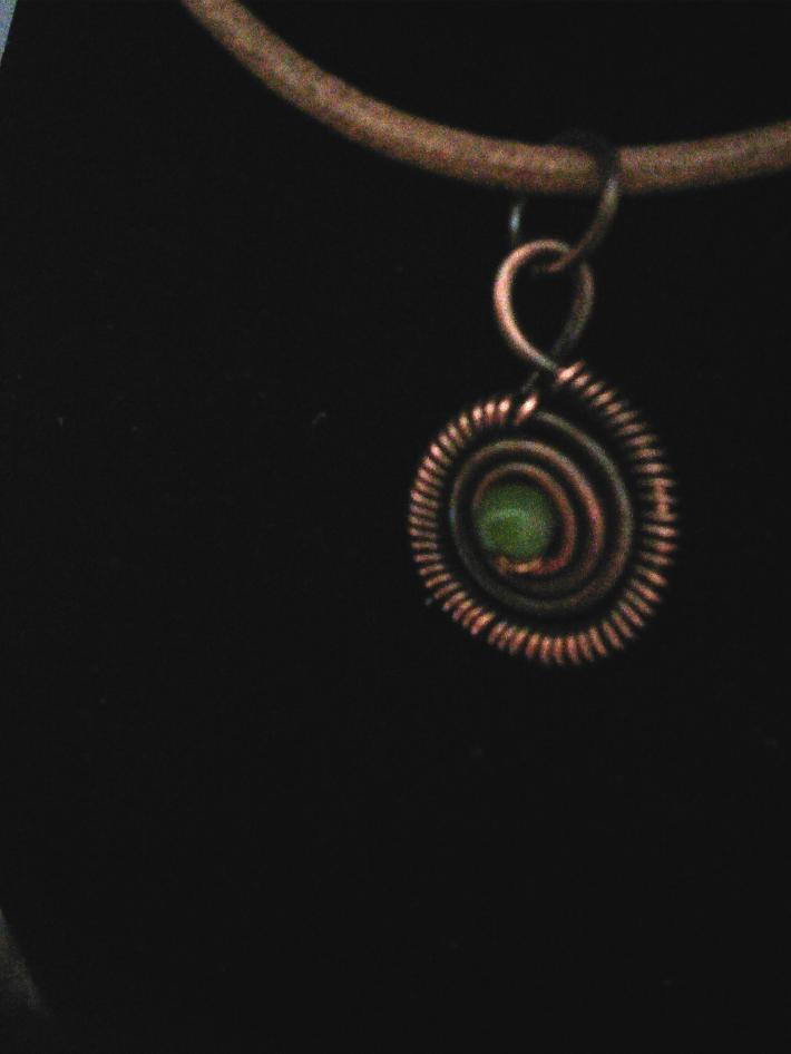 Coiled jade pendant
